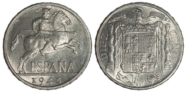 španělské mince s obrázkem dobyvatele